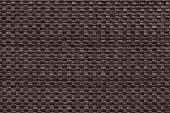 Brown textile background with checkered pattern, closeup. Structure of the fabric macro. Stock Photo