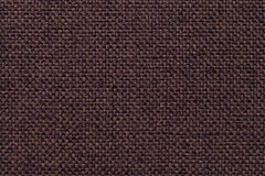Brown textile background with checkered pattern, closeup. Structure of the fabric macro. Royalty Free Stock Images
