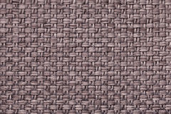 Brown textile background with checkered pattern, closeup. Structure of the fabric macro. Stock Photos