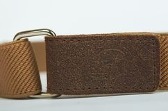 Brown textile kid belt. Isolated on white background. Children clothing accessorry, macro.  stock photos