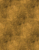 Brown Texture Background. That looks like aged and stained paper or old dirty canvass. Hints of yellow and brown with dark brown/black staining stock photo