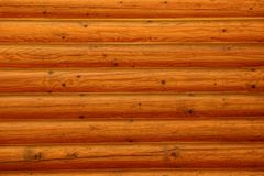 Brown texture of old wooden fence boards. Brown wood background of log fence Stock Images