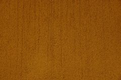 Brown texture of a piece of concrete wall of a building Royalty Free Stock Image