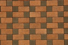 Brown texture of stone paving slab on the road Stock Image