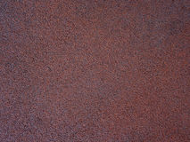 Brown textured background. Rubber texture. red dark background Royalty Free Stock Photography