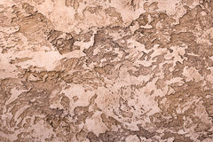 Brown textured clay with a relief pattern for interior. Decorating royalty free stock photography