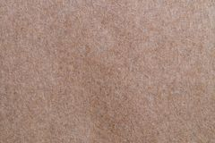 Brown textured rough recycled paper background stock photo