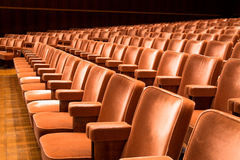 Brown theater seats. Rows of brown theater seats in a concert hall Royalty Free Stock Photography