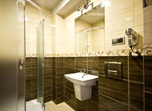 Brown theme bathroom. Elegant modern brown theme bathroom interior Royalty Free Stock Photos
