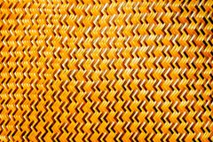 Brown thin bamboo weave is a zig-zag pattern from Thai artisans on handmade in thai art style. Close-up of the brown thin bamboo weave is a zig-zag pattern from Stock Photos
