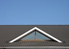 Brown tile roof construction, blue sky, royalty free stock images