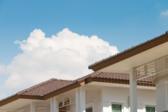 Brown tile roof on a new house Royalty Free Stock Photos
