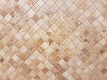 Brown tile wall, marble tiled wall. Texture of brown tile wall, marble tiled wall Royalty Free Stock Images