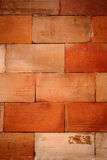 Brown tile wall texture background Royalty Free Stock Photos