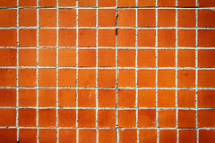 Brown tile wall texture background Royalty Free Stock Image