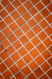 Brown tile wall texture background Royalty Free Stock Images