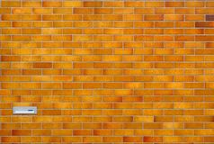 Brown tiled wall with mailbox Royalty Free Stock Photos