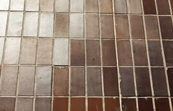 Brown tiles mounted as wall royalty free stock image