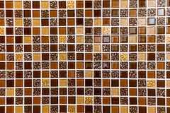 Brown tiles texture on wall Royalty Free Stock Images