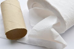 Brown tissue paper core on white background. Brown hard tissue paper core on white background stock images