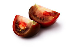 Brown tomato isolated slices Stock Photography