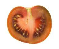 Brown tomato sliced in half Stock Photos