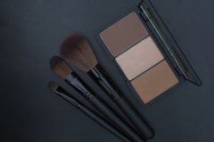 Brown tone face contour and makeup brushes Royalty Free Stock Image