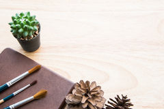 Brown tone table decoration with green cactus and paintbrush royalty free stock image