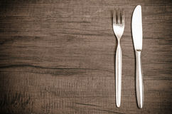 Brown toned wood with fork and knife Royalty Free Stock Photos