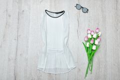 White blouse, glasses and a bouquet of tulips. Fashionable conce Royalty Free Stock Image