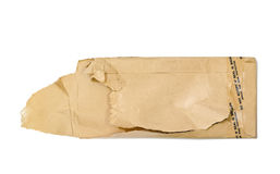 Brown torn envelope. On white background royalty free stock images