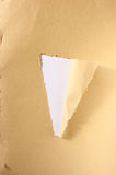 Brown torn paper with hole. Stock Photo