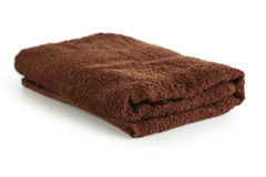 Brown towel isolated on a white Stock Photos