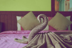 Brown towel plait as swan on bed vintage style Stock Photography