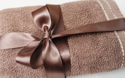 Brown towel tied with a bow Stock Photo