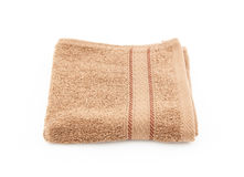 Brown towel on white background Royalty Free Stock Photo