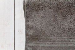 Brown towel on white wooden table Stock Images