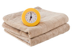 Brown towel with yellow watch Royalty Free Stock Photos