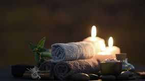 Beauty spa treatment with candles stock footage