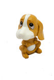 Brown toy dog. Plastic brown toy dog on white background Stock Photography