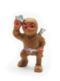 Brown Toy Ninja. Isolated Brown Plastic Ninja on White Background Royalty Free Stock Images