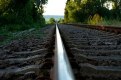 Brown Train Rail on Close Up Photo during Daytime stock image