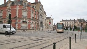 Brown tram in the center of Orleans, France. Orleans, France - 21 December 2014: Brown tram in the center of Orleans, France stock video footage