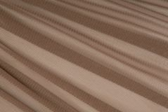 Brown transparent caprone cloth. Texturing background Royalty Free Stock Photography