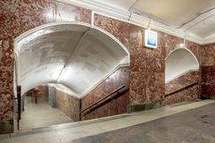 Brown tunnel in Metro station at Moscow. Brown tunnel with pathway go down to metro station at Moscow, Landscape of sidewalk way with stair banisters and curve Stock Images