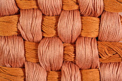 Brown twisted skeins of floss as background texture Royalty Free Stock Photo