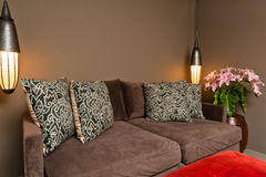 Brown two seated sofa dark ambience. Brown two seated sofa beautiful dark ambience Stock Images