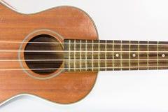 Brown ukulele część odizolowywająca na bielu Obrazy Royalty Free