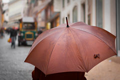 Brown umbrella. In Chiado, an old district of Lisbon Royalty Free Stock Images