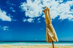 Brown Umbrella on Seashore stock photography